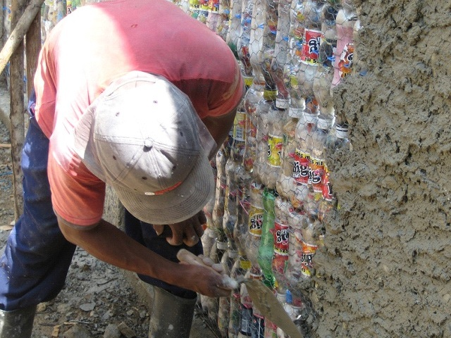 Cinderblocks are replaced with plastic bottles.