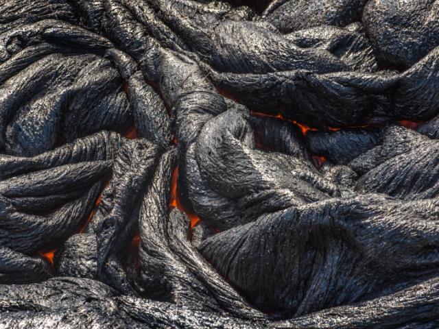 A photo of magma in a lava field in the Hawaii Volcanoes National Park